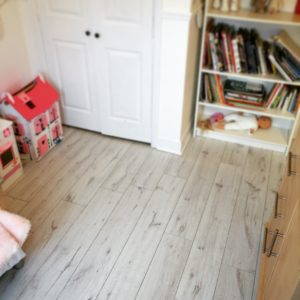 book shelf with white door and doll house