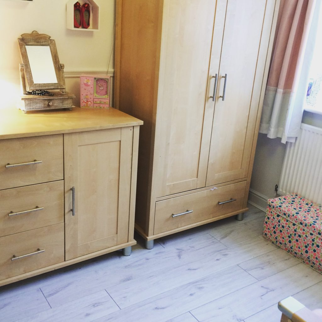 light brown wood cabinet in bed room
